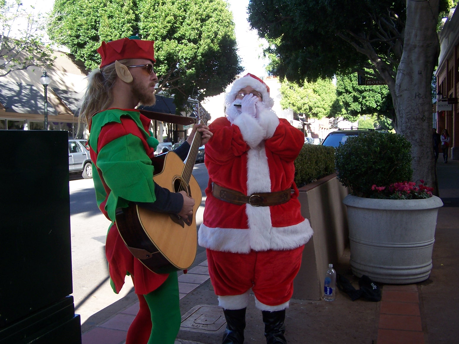 The Grooviest Santa and Elf Around